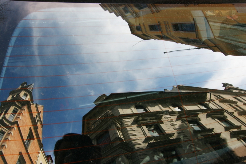 Cityscape As A Reflection On A Car
