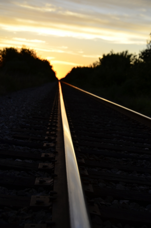 Shimmering Railroad Tracks At Sunset