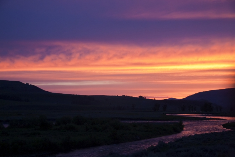 A Colorful Sunset Reflects In The Yellowstone River At Lamar Valley, Yellowstone National Park