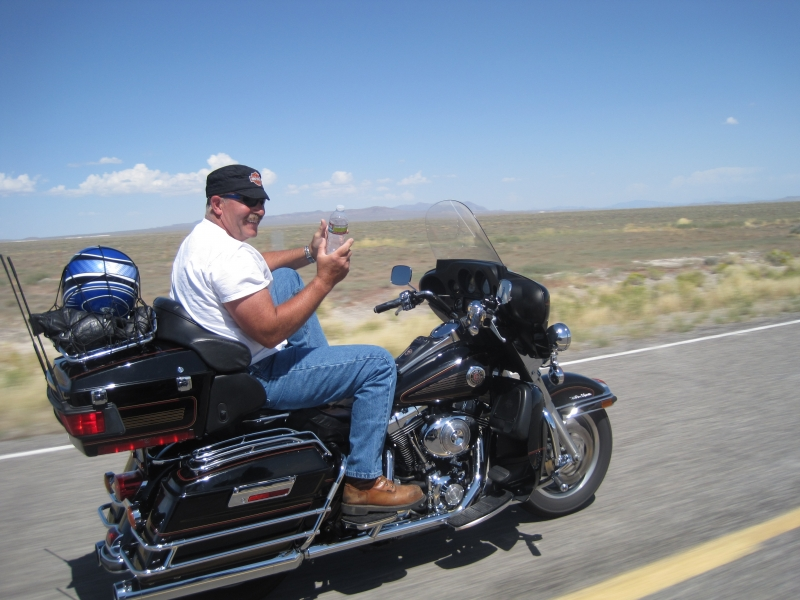 Randy Offering Us A Bottle Of Water In The Nevada Desert