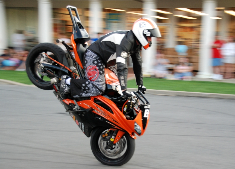 Stunt Man On Front Tire