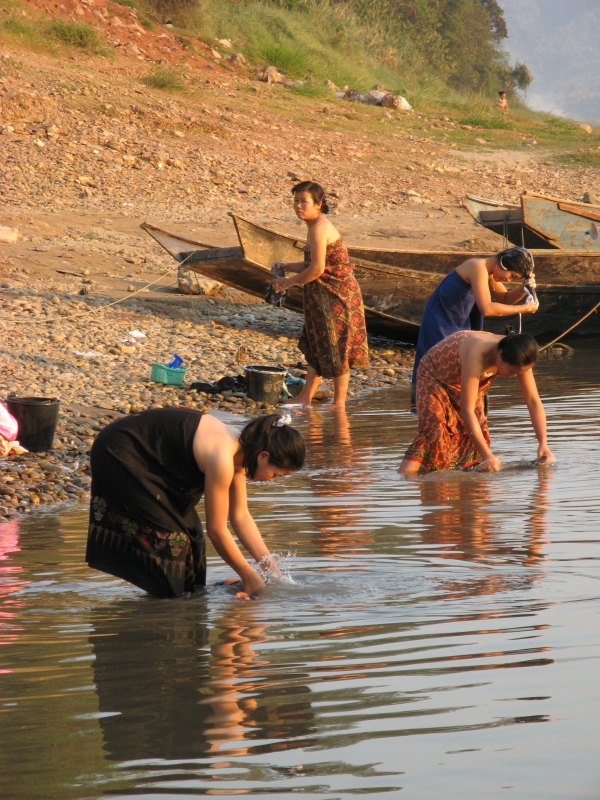 Women Bathing In The Mekong River
