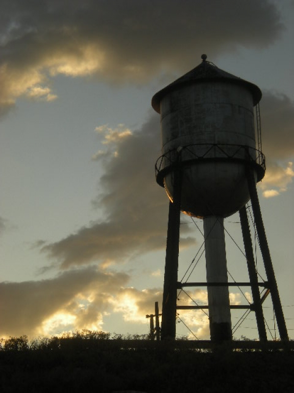 Water Tank At Sunset