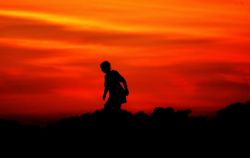 Silhouette At Sunset