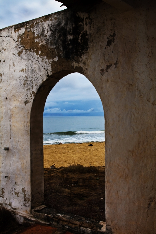 Looking Through Deserted Bathhouse Door At Ocean