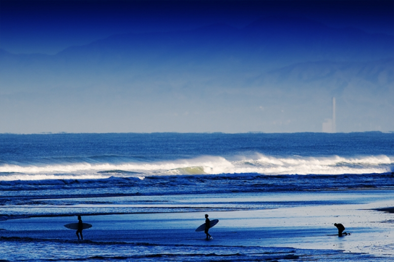 Three Surfers