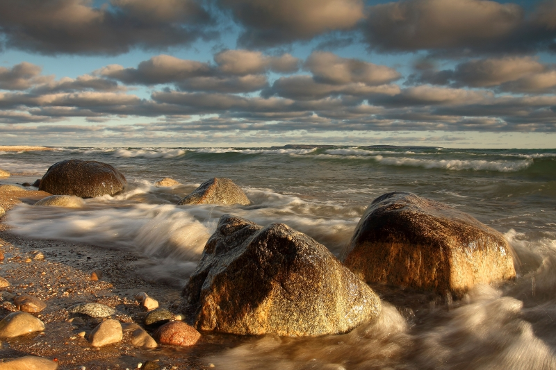 Waves, Boulders, And Clouds On Lake Michigan