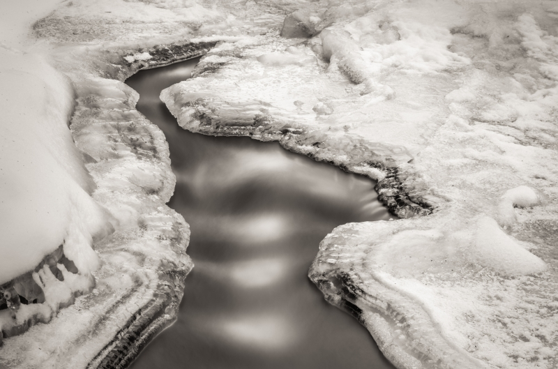 Wolf River – Water Flowing Through Ice