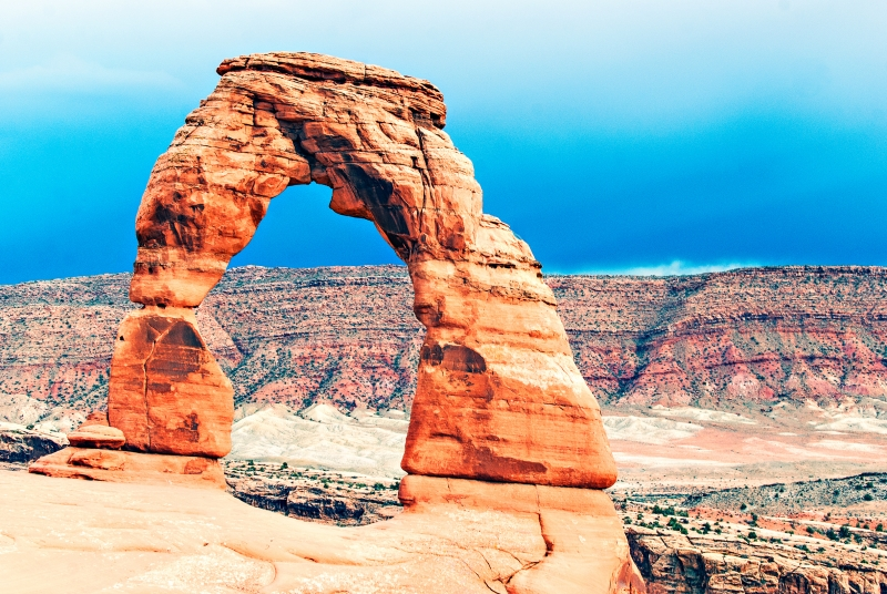 Delicate Arch Stands In Reverence In The Sandstone Landscape
