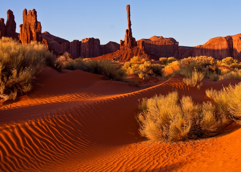 Sunrise In Red Sands Near Totem Pole In Monument Valley