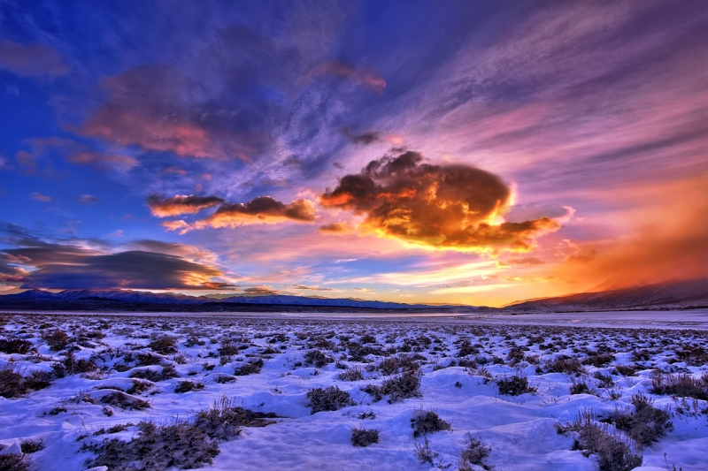 A Colorful Sunrise Over A Snowy Crowley Lake