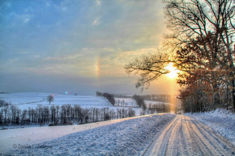 Sun Dog Over Snowy Country Road