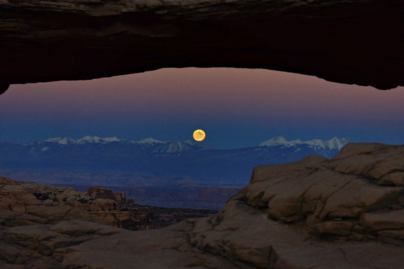 Moonrise Through Mesa Arch