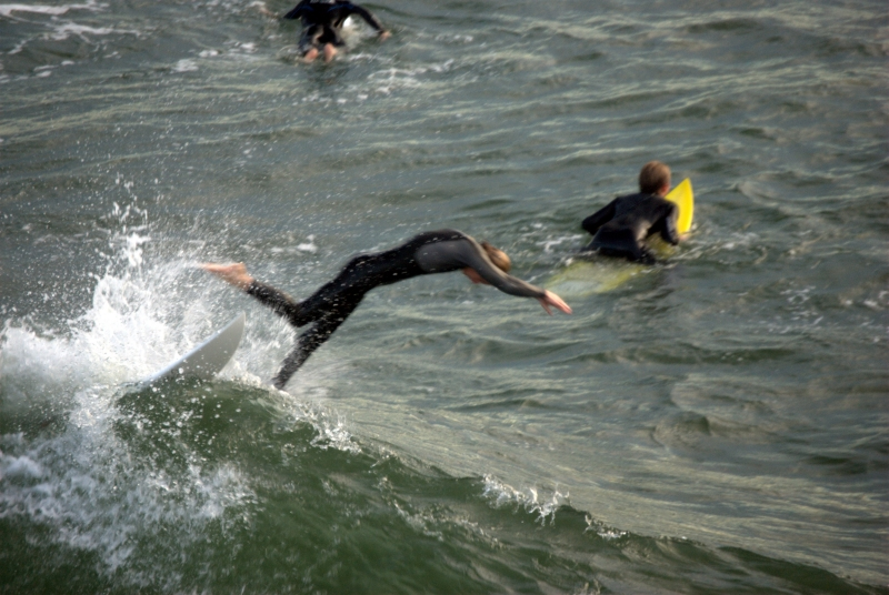 Surfer Takes A Dive