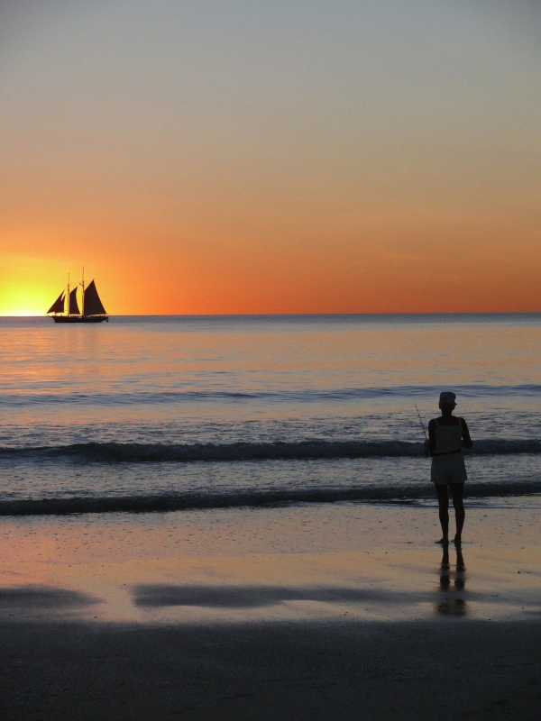 A Lady Fishing On Cable Beach, Western Australia
