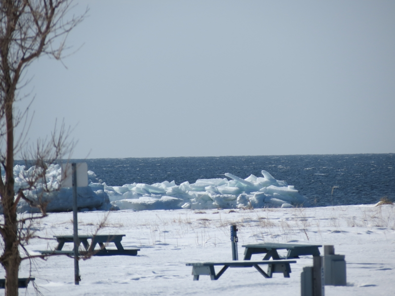 Ice Offshore And Picnic Tables , Area Full Of Snow.