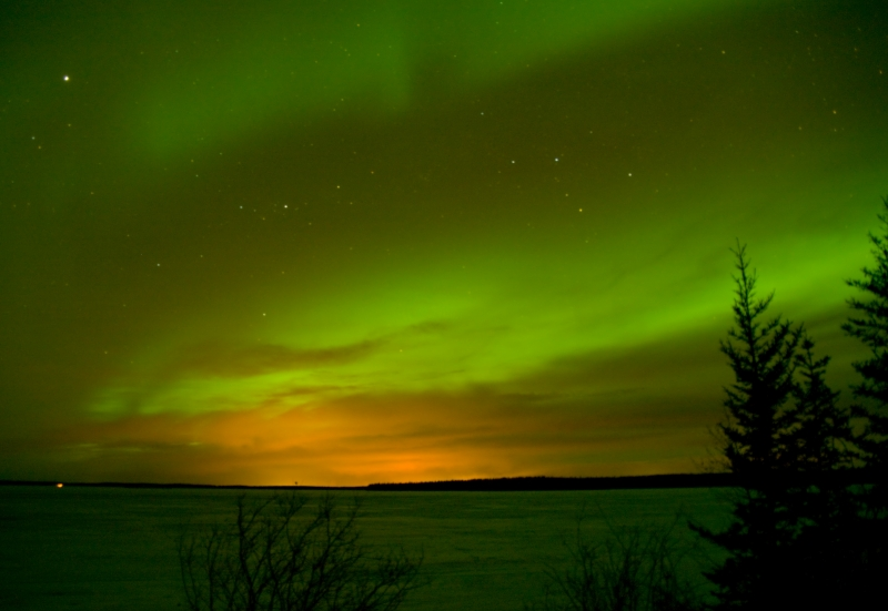 A Glow Of Fort Mcmurray Through Northern Lights