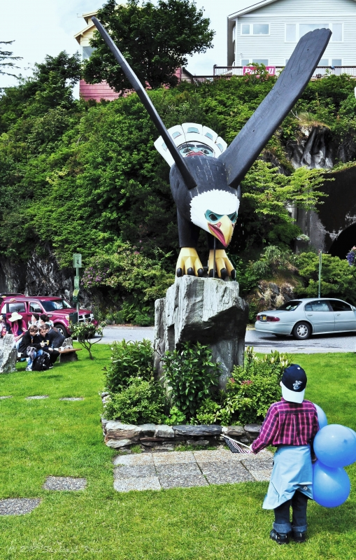 Boy Ponders Menacing Eagle Wood Sculpture