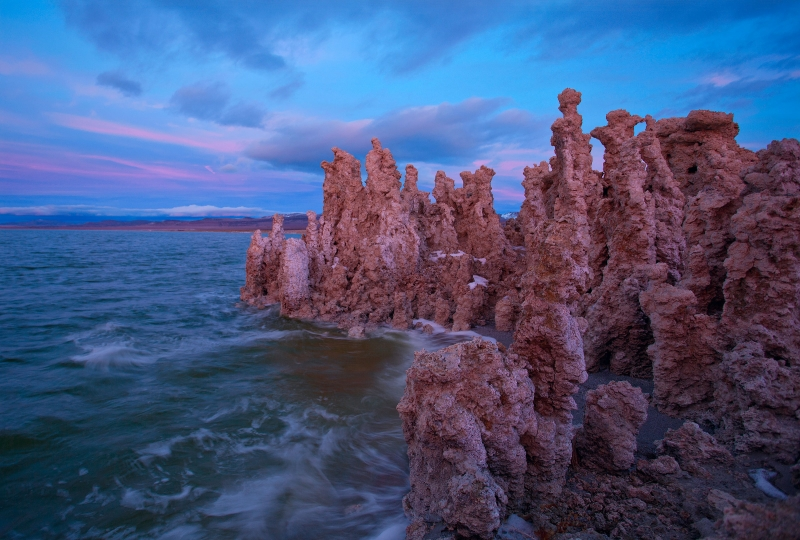 Tufas With Waves At Sunset