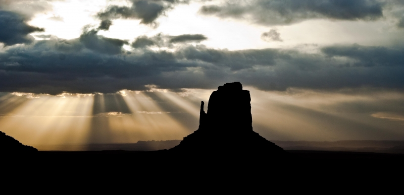 Mitten With Sun Rays Through Clouds