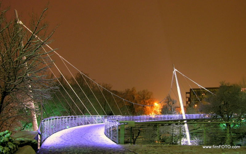 Snowy Night At Liberty Bridge In Falls Park