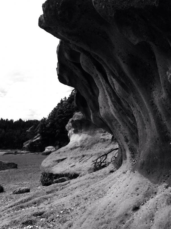 Waves In Sandstone Formed By Crashing Water