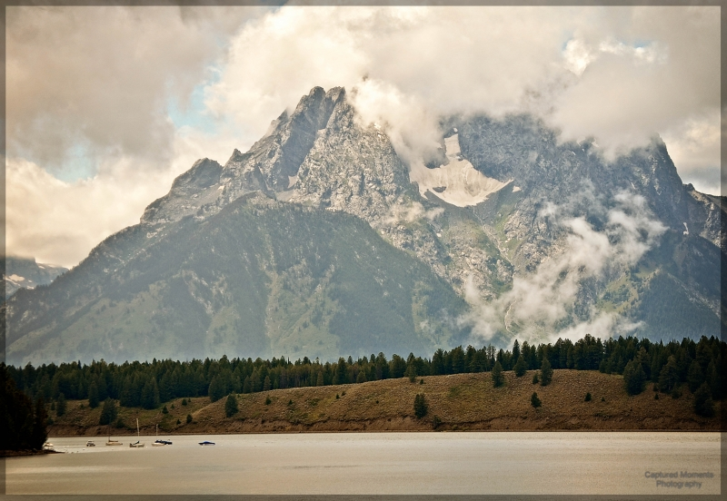 Boats Are Dwarfed By The Mighty Tetons