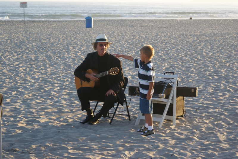Wedding Musician Cahtting With A Kid