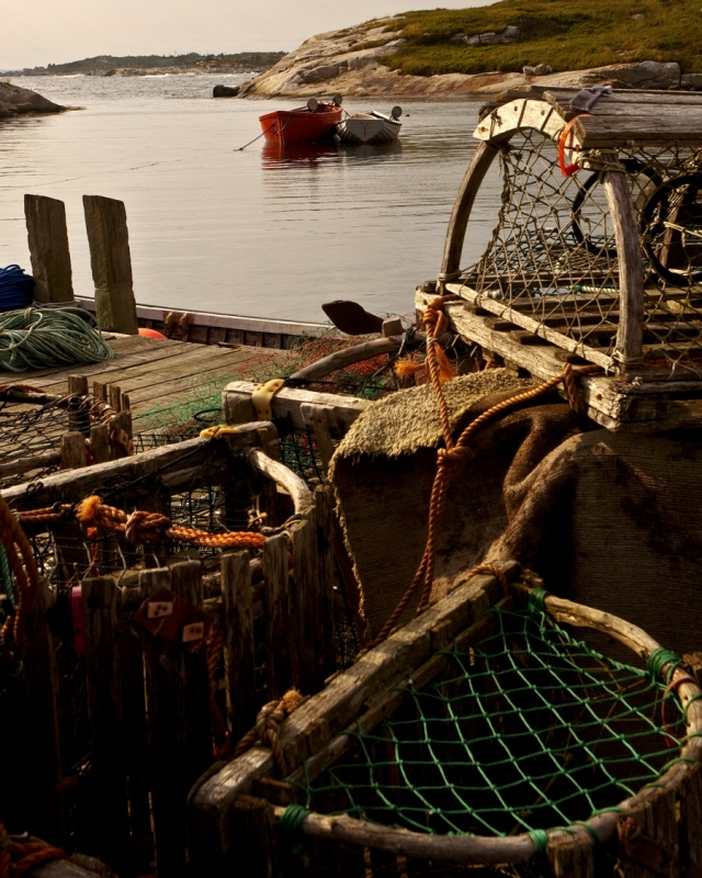 Lobster Nets With Boats In Harbor