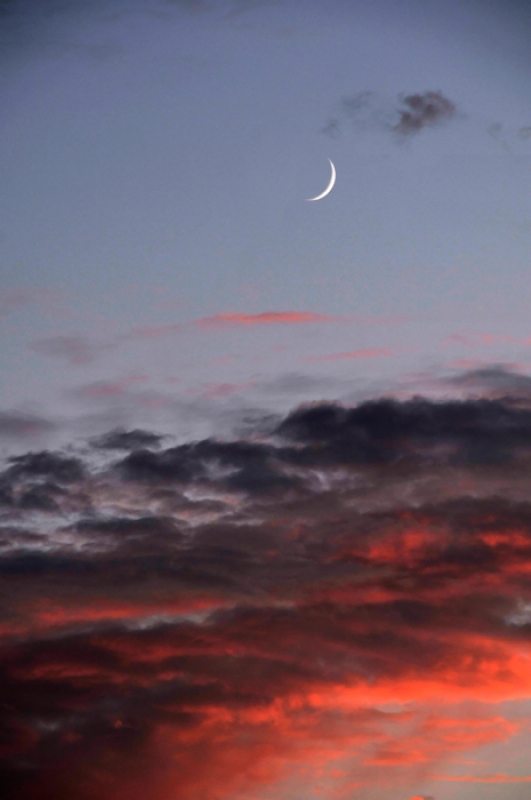 Sunset And Crescent Moon