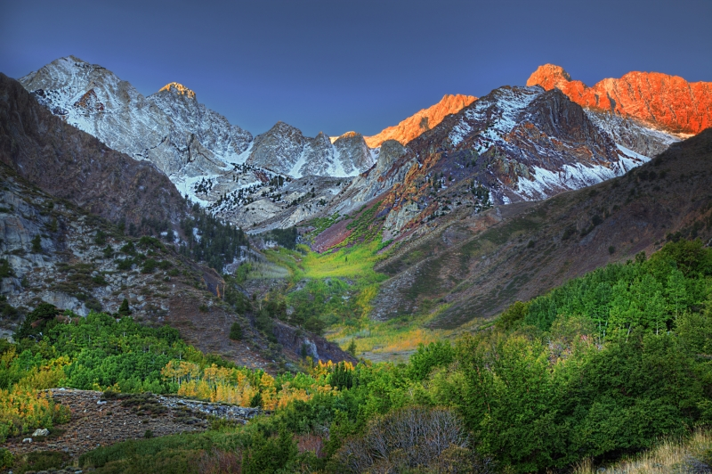 Sunlit Backdrop In A Valley Of Color