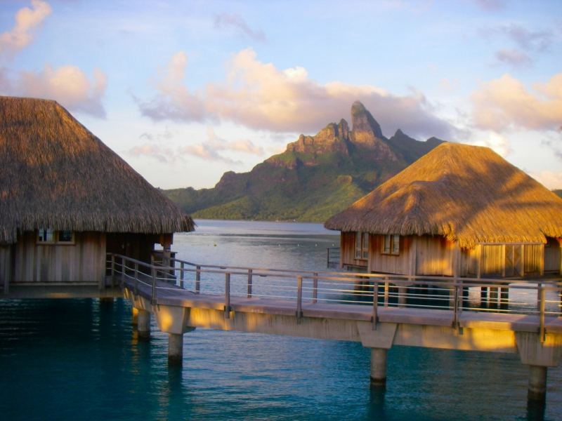 Bora Bora Island And St. Regis Huts At Sunrise