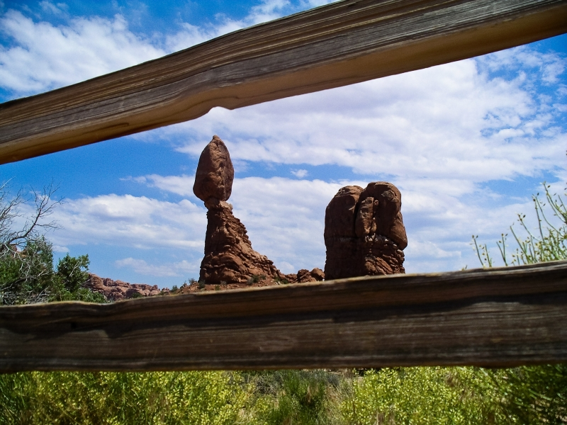Balancing Rock Through Fence