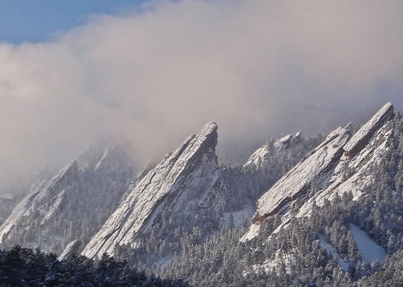 The Flatirons Enshouded In Fog And Snow