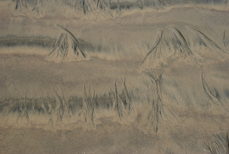 Indian Tepees In The Sand