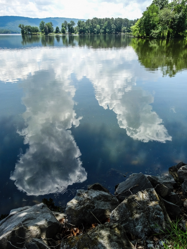 Towering Clouds Reflection
