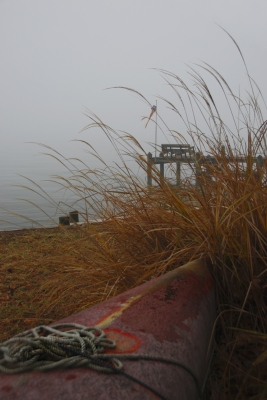 Fog Surrounding Pier And Red Canoe