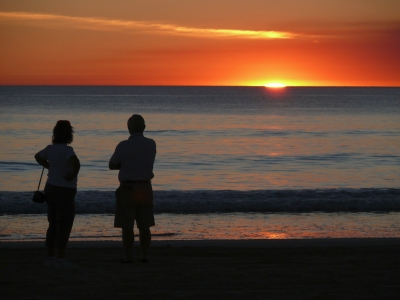 Tourists Watch The Sunset On Cable Beach, Western Australia