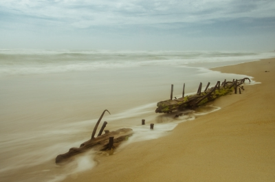 Misty Shipwreck On The Beach