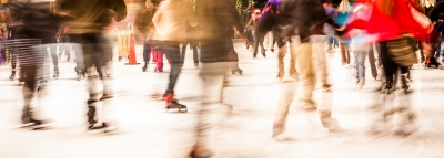 Ice Skaters In Motion