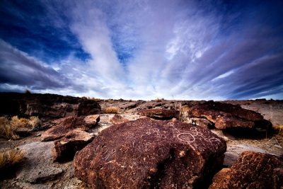 Petroglyph And Clouds