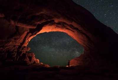 Hiker Looks Into The Milky Way