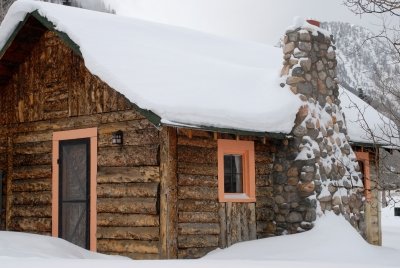 Log Cabin Under Heavy Snow