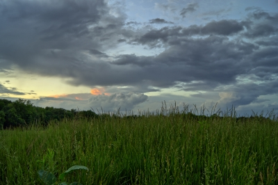 Clouds Over The Grassy Mound