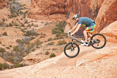 Jed Weber Mountain Biking The Slickrock Trail On Sandstone Of The Colorado Plateau Near The City Of Moab In Southern Utah