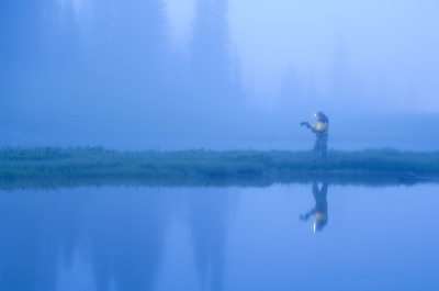 Reading A Map With A Headlamp In The Fog