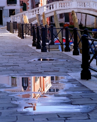 Reflection In A Puddle In Venice