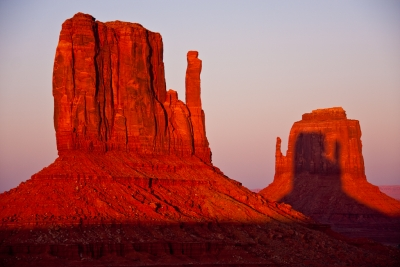 Sunset With Shadow Of Right Mitten On Left Mitten In Monument Valley.