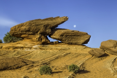 Rock Formations Framing The Moon