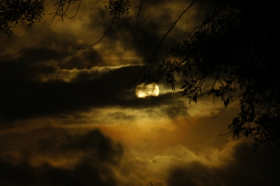 Sun Behind Angry Clouds
